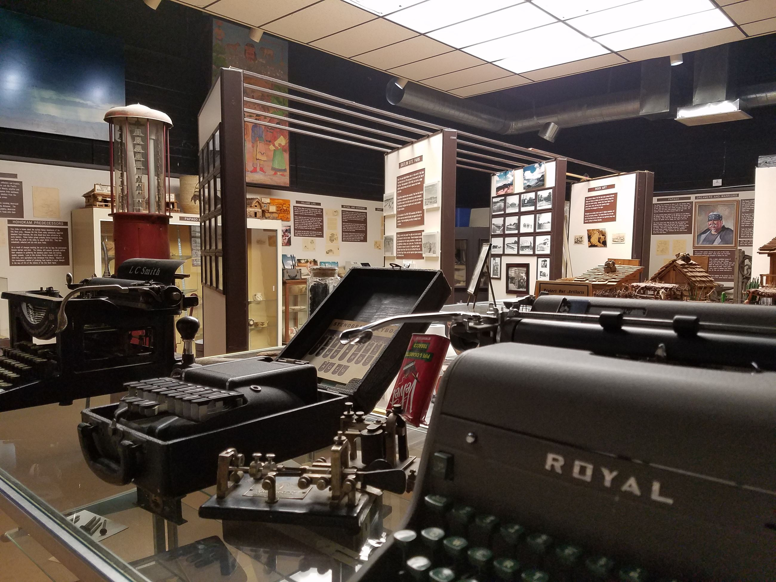 Museum view from front entrance with typewriter collection in front and new display cases at back