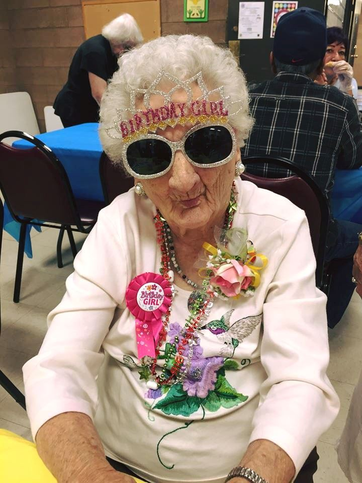 Margie Lonas wearing birthday sunglasses at her 100th birthday party